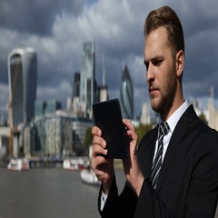 Corporate Businessperson Working with Digital Tablet London Skyline Central Town Stock Footage