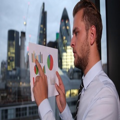 Businessman Manager Reading Pie Chart Checking Data Sales Report London Skyline Stock Footage