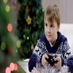 Young boy playing playstation Stock Footage