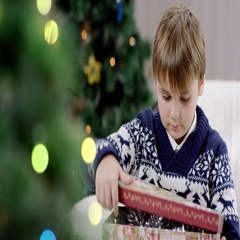 Young boy opening Christmas presents Stock Footage
