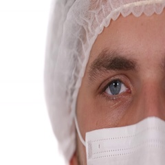 Close Up Portrait Medical Doctor Man Looking Camera Surgical Mask Hospital Room Stock Footage