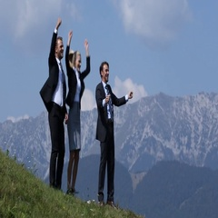 Success Achievement and Accomplishment Concept with Business People on Mountain Stock Footage