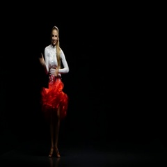 Woman dancing rumba in a studio on a dark background Stock Footage