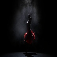 Dancer girl in beautiful dress in the studio on a dark background, smoke Stock Footage