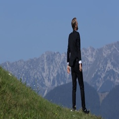 Happy Successful  Businessman Pose Standing on Top of a Mountain Raising Hands Stock Footage
