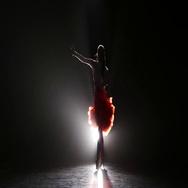 Beautiful girl dancing rumba in the studio on a dark background, smoke, with Stock Footage