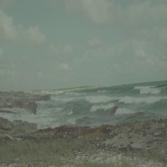 Waves Crash on Rocky Beach During Storm Stock Footage