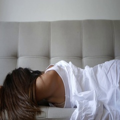 Sleepy woman on a sofa Stock Footage
