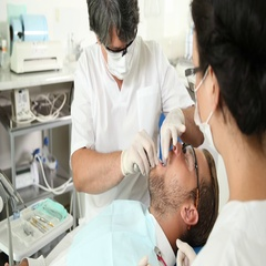 Dentist Man Surgery Pull Up Tooth Using Removal Tool Patient Lying Dental Clinic Stock Footage