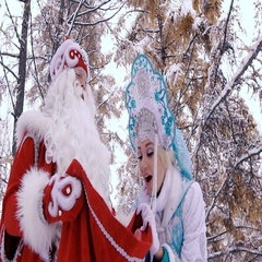Man and woman in New Year costumes on Christmas Eve are happy to see the gifts Stock Footage