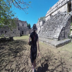 A gimbal shot of tourist woman walking in Ek Balam Mayan Ruins Stock Footage