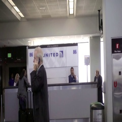 United Airlines passenger talking on cell phone window at Newark Airport Stock Footage
