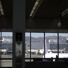 Passengers, travelers looking out large interior windows at plane Stock Footage