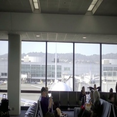 People sitting in waiting area at gate with window view outside, interior Stock Footage