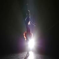 Beautiful girl dancing samba in the studio on a dark background, smoke Stock Footage