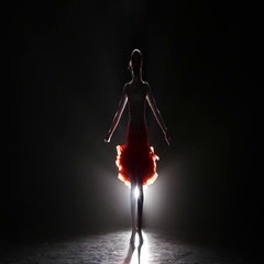 Beautiful girl dancing cha-cha-cha in the studio on a dark background, smoke Stock Footage