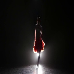 Professional dancer in beautiful dress in the studio on a dark background, with Stock Footage