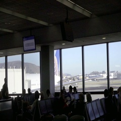 Moving shot inside Airport interior - EWR passengers waiting for flight Stock Footage