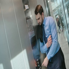 Businessman pressing button in elevator Stock Footage