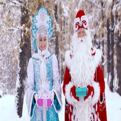 Portrait of Father Frost and smiling Snow Maiden showing gifts to the camera Stock Footage