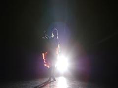 Lady dancing samba in the studio on a dark background, smoke, silhouette Stock Footage