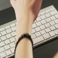 Woman Typing on a Keyboard and Making Gestures Stock Footage