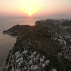 Aerial view of a sunset over the resort town near the Aegean Stock Footage
