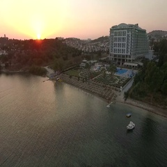 Aerial view of the stunning sunset over the Aegean Sea, the resort town Stock Footage