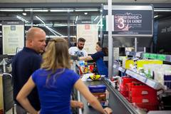 Customers paying for shopping at a supermarket. Line at the cash Kuvituskuvat