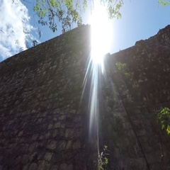 Gimbal shot of a woman tourist walking at Ek Balam Mayan Ruins Stock Footage