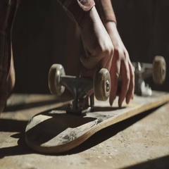 Man spins the screws on skateboard Stock Footage