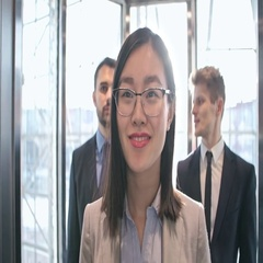 Businessmen and businesswoman in elevator Arkistovideo