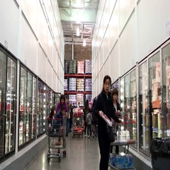 One side of people shopping inside Costco store Stock Footage