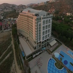 Aerial view over an hotel building in the resort town near the Aegean Sea Stock Footage