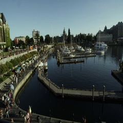 Panning view of harbor towards The Empress Hotel Stock Footage