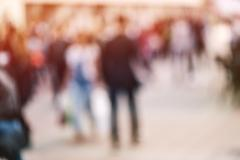 Abstract blur crowd of people on street in rush hour Stock Photos