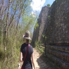 Gimbal shot of woman tourist walking at Ek Balam Mayan Ruins Stock Footage