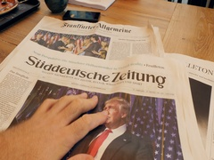 Reading in German Cafe about Donald Trump victory Stock Footage