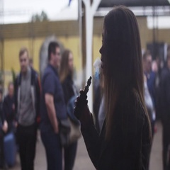 Girl exhalation steam from electronic cigarette on street. Festival of vapers Stock Footage