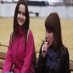 Smoker exhalation steam from electronic cigarette at beach. Girl wave hand Stock Footage