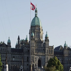 Flag waving in front of the Britsh Coumbia Parliment building Stock Footage