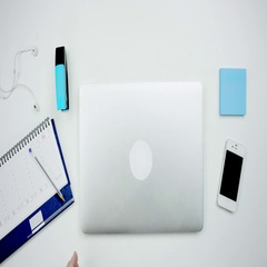 Top view of a man openning a laptop and starting to work Stock Footage