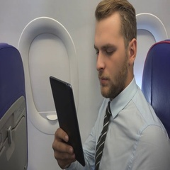 Busy Ceo Businessman Use Digital Tablet Navigate Online Onboard Airplane Travel Stock Footage