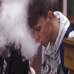 Young boy smoke electronic cigarette on street with friend. Vaper. Lot of steam Stock Footage