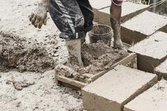 Making traditional adobe mud bricks, Paru Paru, Pisaq, Peru Stock Photos