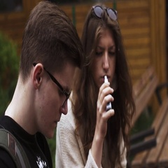 Girl and man in glasses smoke electronic cigarette. Vapers. Lot of steam Stock Footage