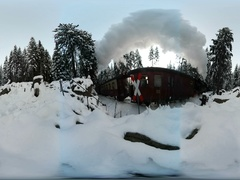 360 VR Narrow gauge steam locomotive passing by in snow winter forest Harz GER Stock Footage