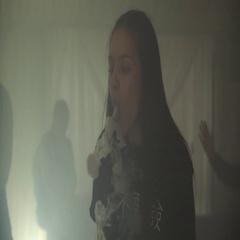 Brunette girl exhale steam rings from electronic cigarette. Vaper. Subculture Stock Footage