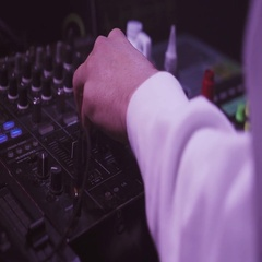 Dj spinning, mixing at turntable on party in nightclub. Spotlights. Celebration Stock Footage