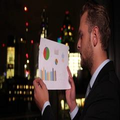 Banker Businessman Read Profit Statistics and Analyzing London Skyline Buildings Stock Footage